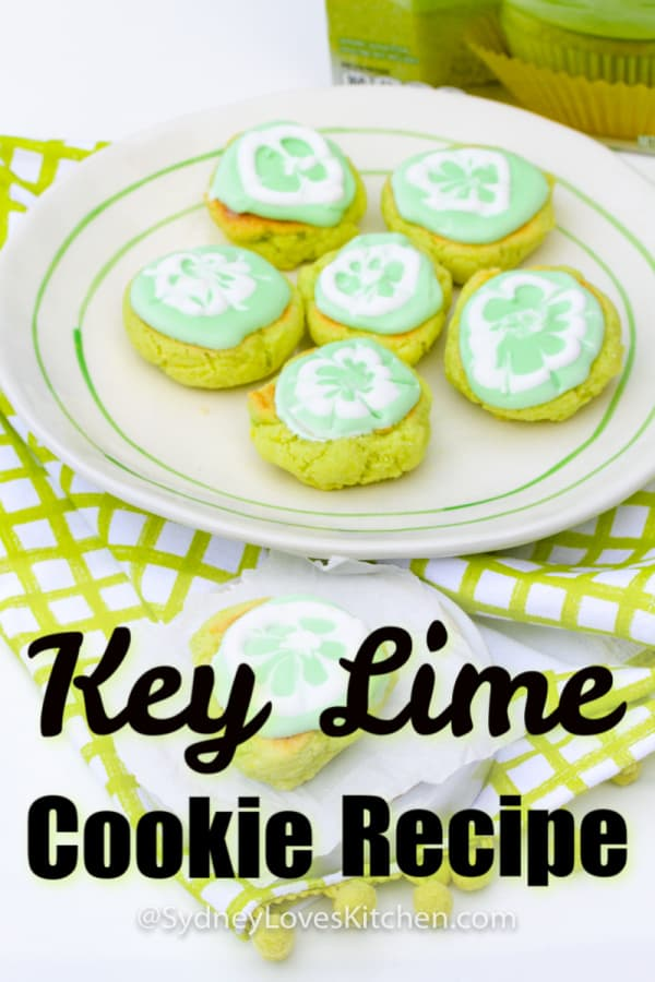 six key lime cookies on a plate and one key lime cookie on a smaller plate in front of larger plate of cookies