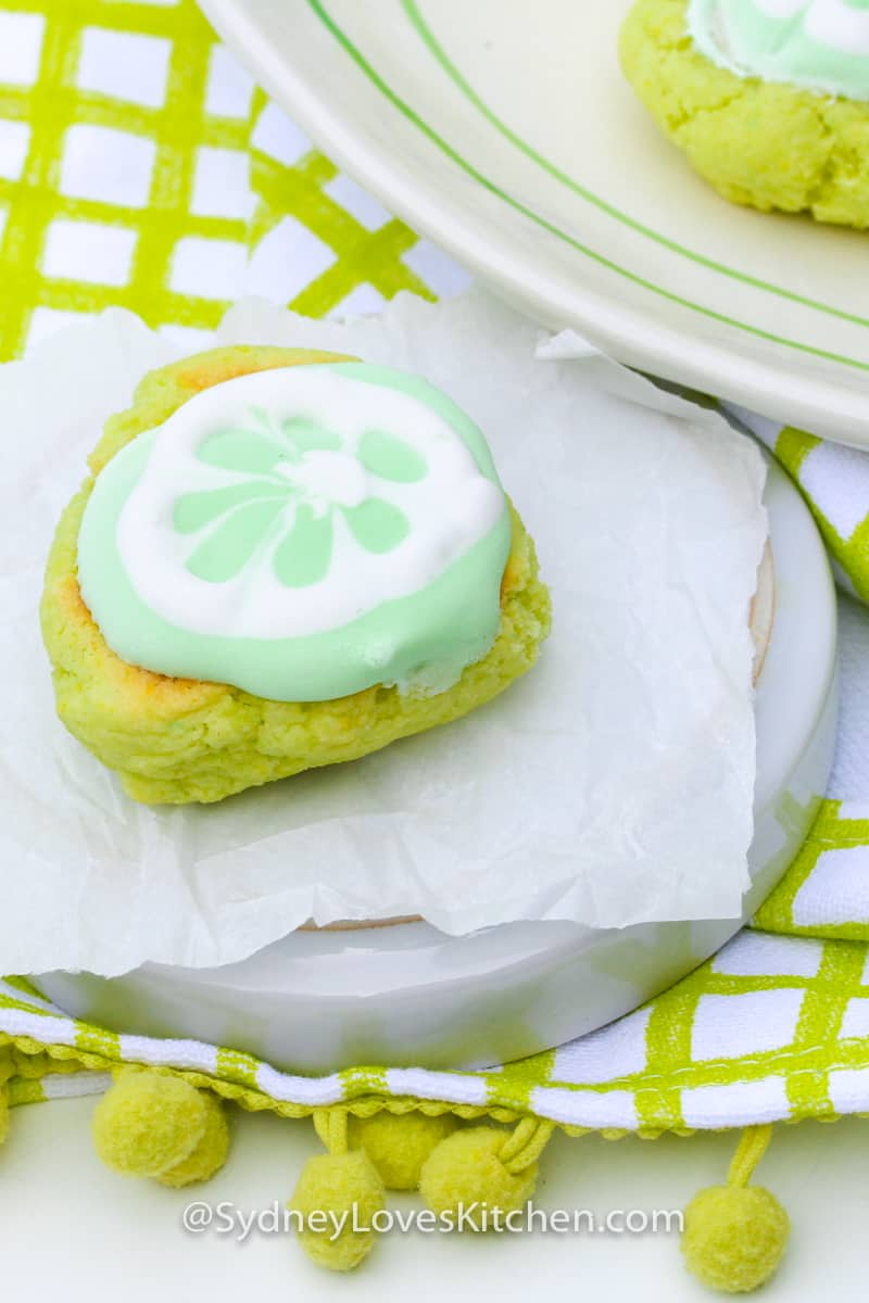 key lime cookie on a plate placed on a green checkered table cloth