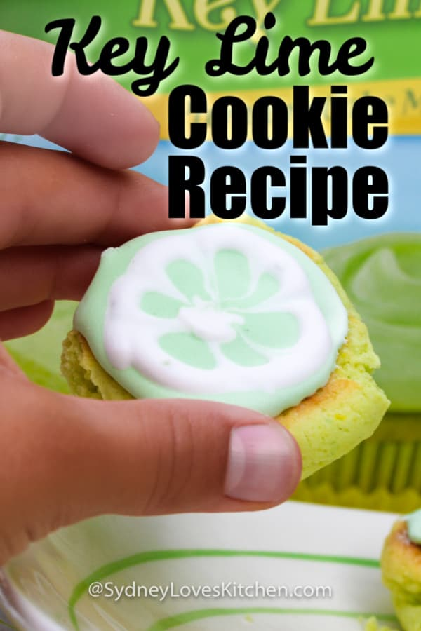 hand holding key lime cookie in front of Pillsbury key lime cake mix box