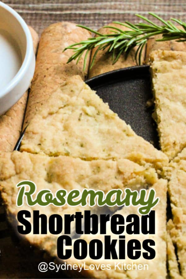 rosemary shortbread cookie shown as a pie with one slice removed and a sprig of rosemary.
