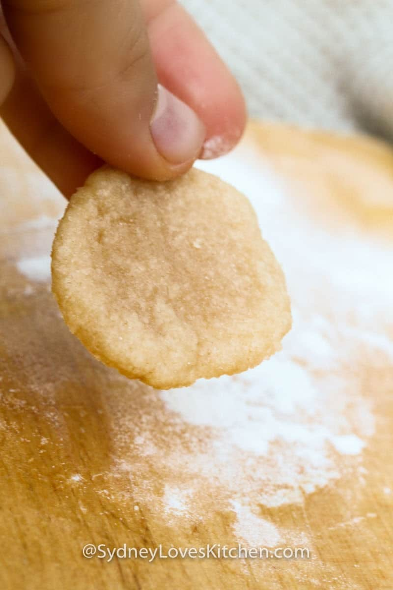 holding an Easy Bake Oven sugar cookie
