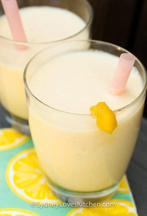 closeup of mango smoothies garnished with mango