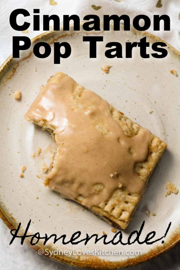 Overhead view of homemade pop tart with glaze on a plate.